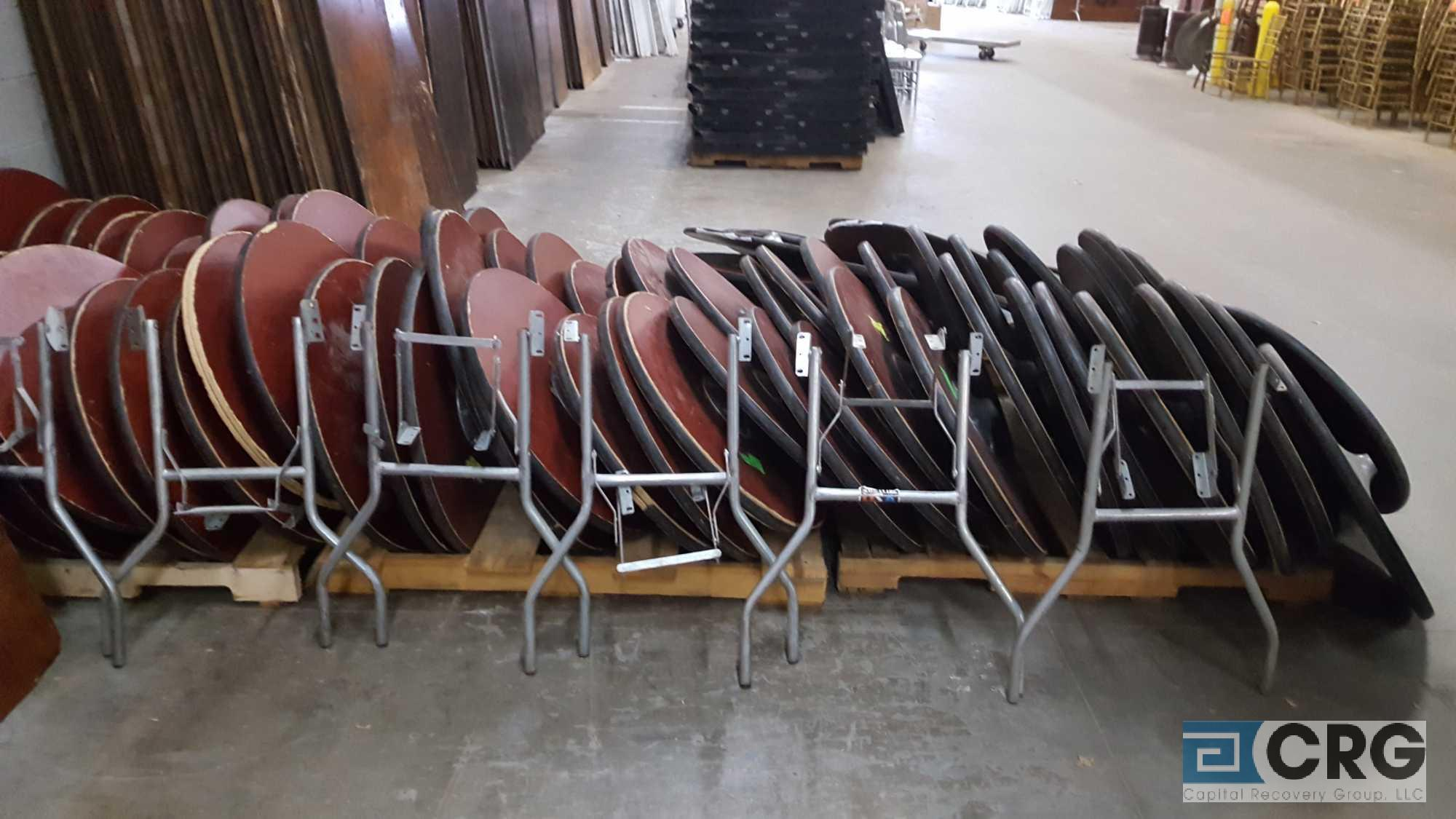 "Lot 124A - Lot of (81) assorted 24"" diameter pedestal tables, with 82 assorted posts, no bases, and 3 pair"