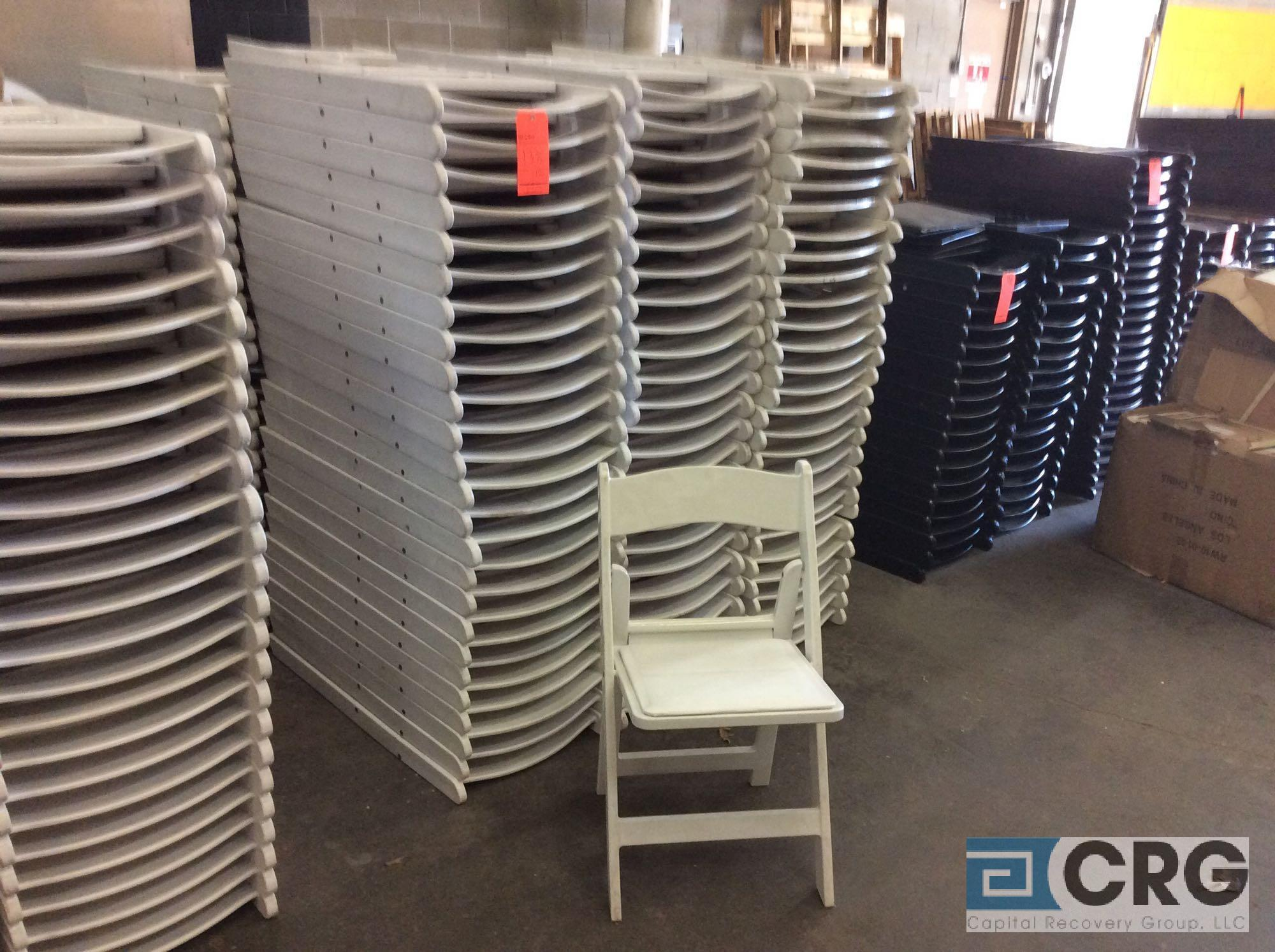 Lot 138 - Lot of (150) assorted white resin folding chairs.