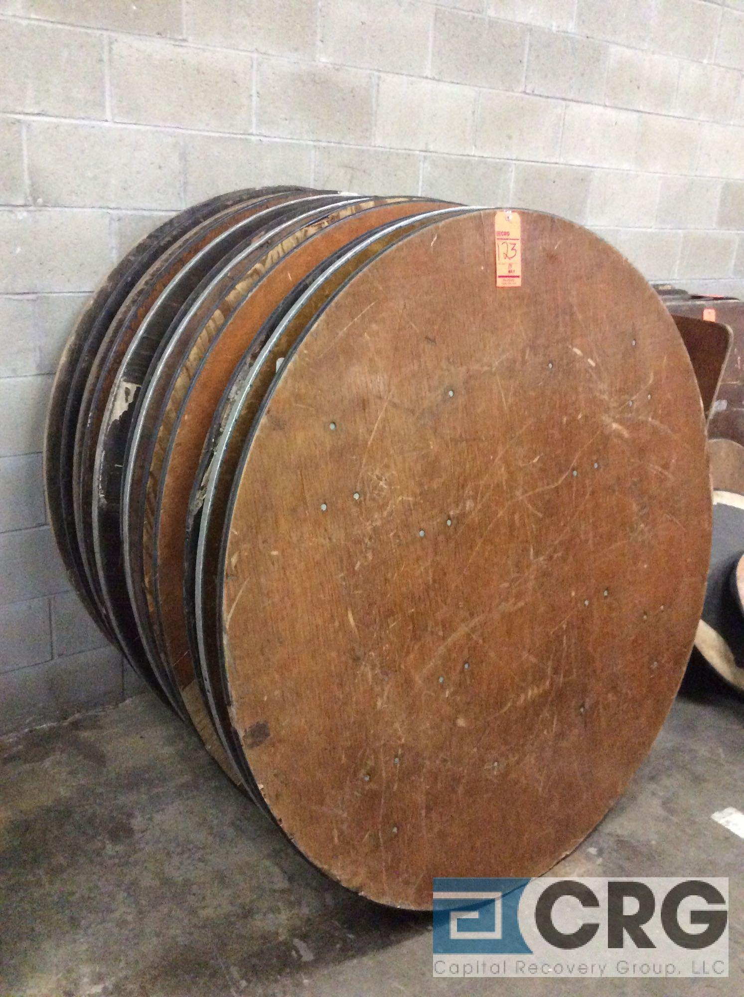 "Lot 123 - Lot of (13) assorted folding leg wood banquet tables, (1) 72"" diameter, and (12) 60"" diameter."