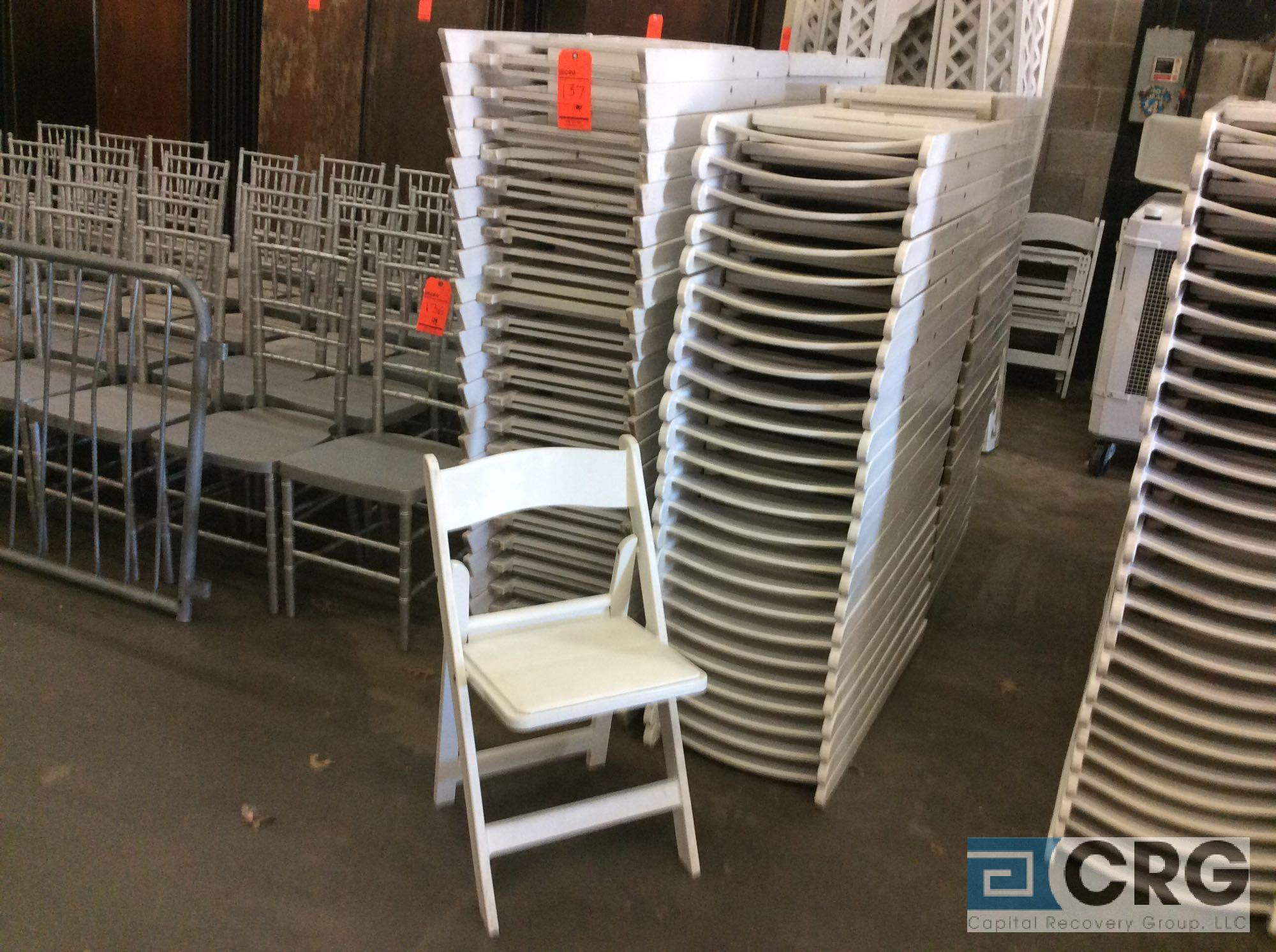 Lot 137 - Lot of (100) assorted white resin folding chairs.