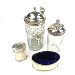A group of four early/mid 19th century silver and glass condiments.