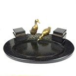 A large black marble and brass desk inkstand.