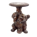 A Swiss Black Forest Bear piano stool, early 20th century.