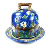 A Minton style majolica Stilton cheese dish and cover, late 19th/early 20th century.