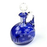 A Victorian engraved Bristol blue glass decanter.