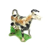 A Staffordshire pottery cow creamer, 19th century.