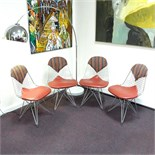 A group of four Charles and Ray Eames wire dining chairs, post 1951.
