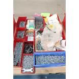 Nine bins of machine bolts, bins included