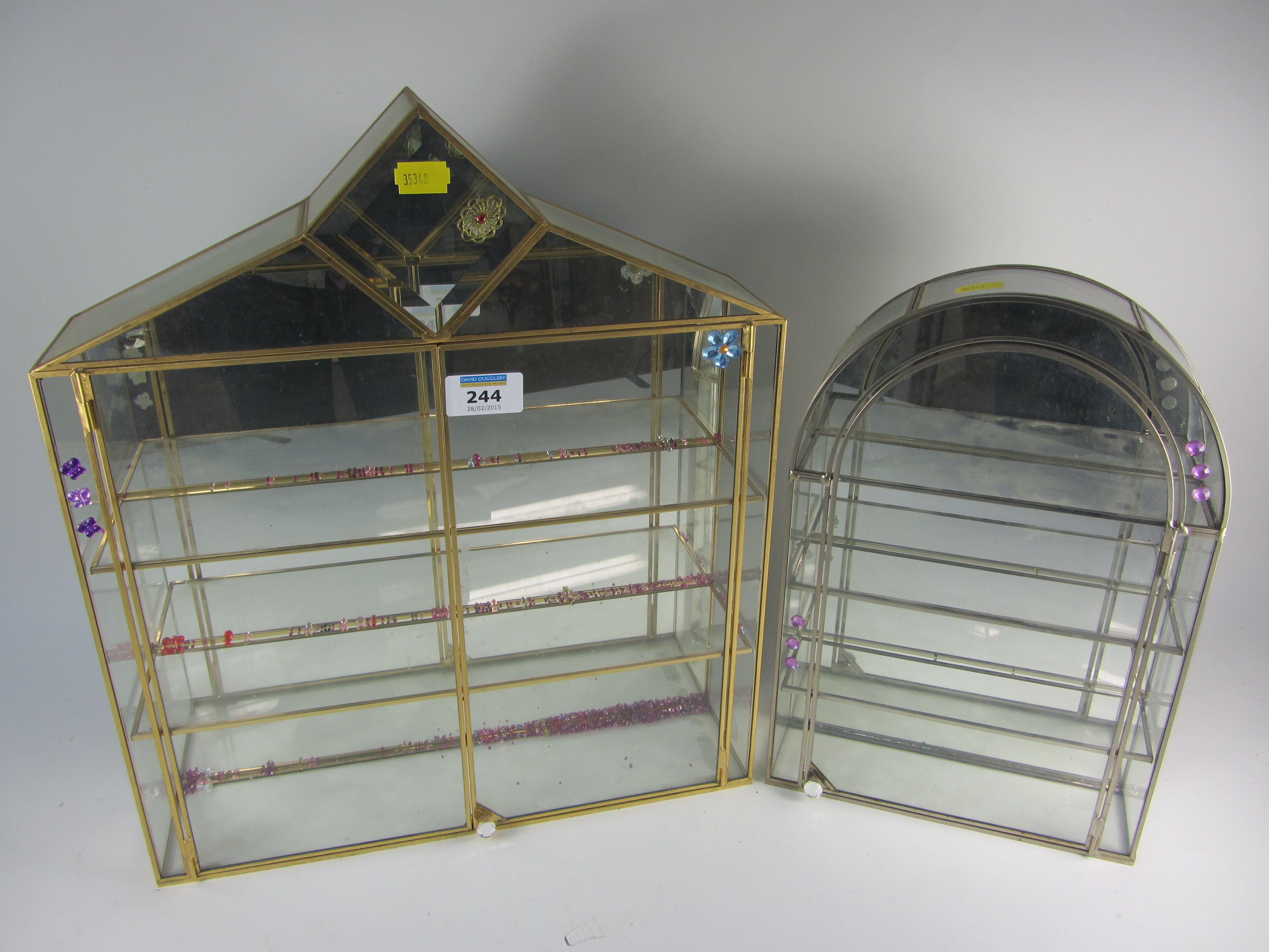 Lot 244 - Two display cabinets for Swarovski cryst & Two display cabinets for Swarovski crystal and two Arribas Disney ...