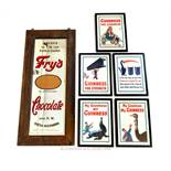 A large, Fry's Chocolate framed mirror and five, framed, Guinness prints
