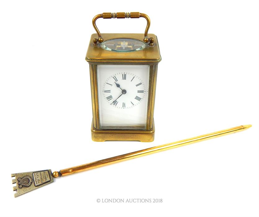Lot 57 - A brass carriage clock with a brass page turner engraved 'Danny Kaye'