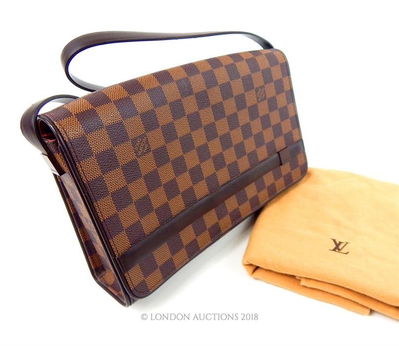 Lot 55 - A Louis Vuitton, traditional, checkered, brown leather handbag