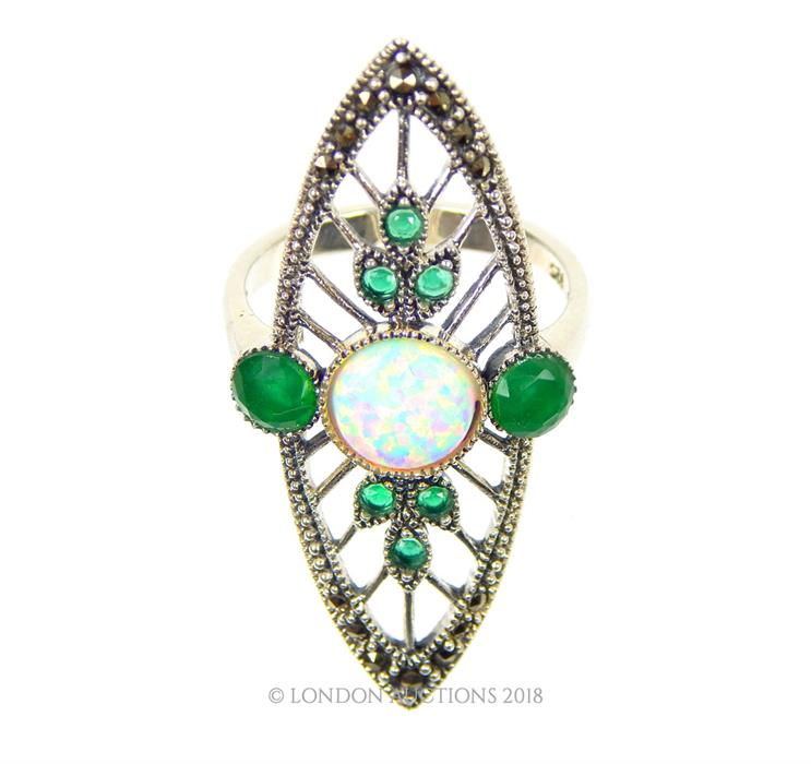 Lot 49 - An Art Deco -style silver ring set with emeralds and opalites