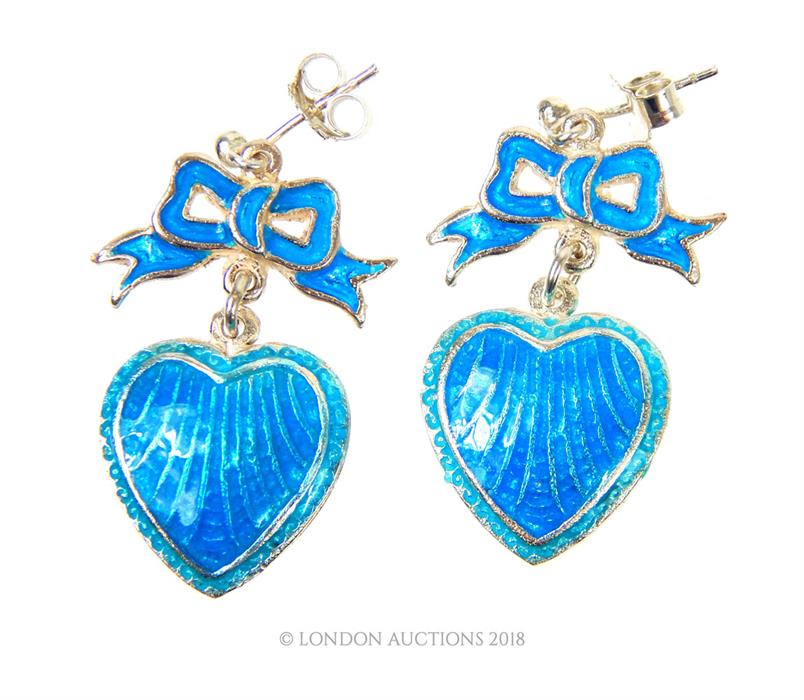 Lot 18 - A pair of silver and blue enamel drop heart earrings