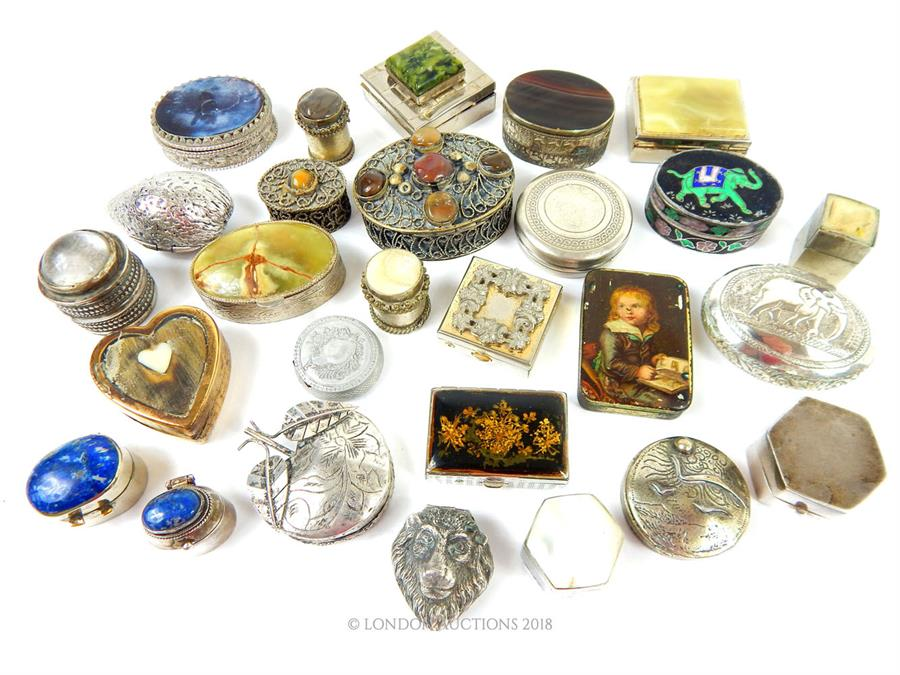 Lot 38 - A collection of twenty-seven, silver and white metal pill and trinket boxes