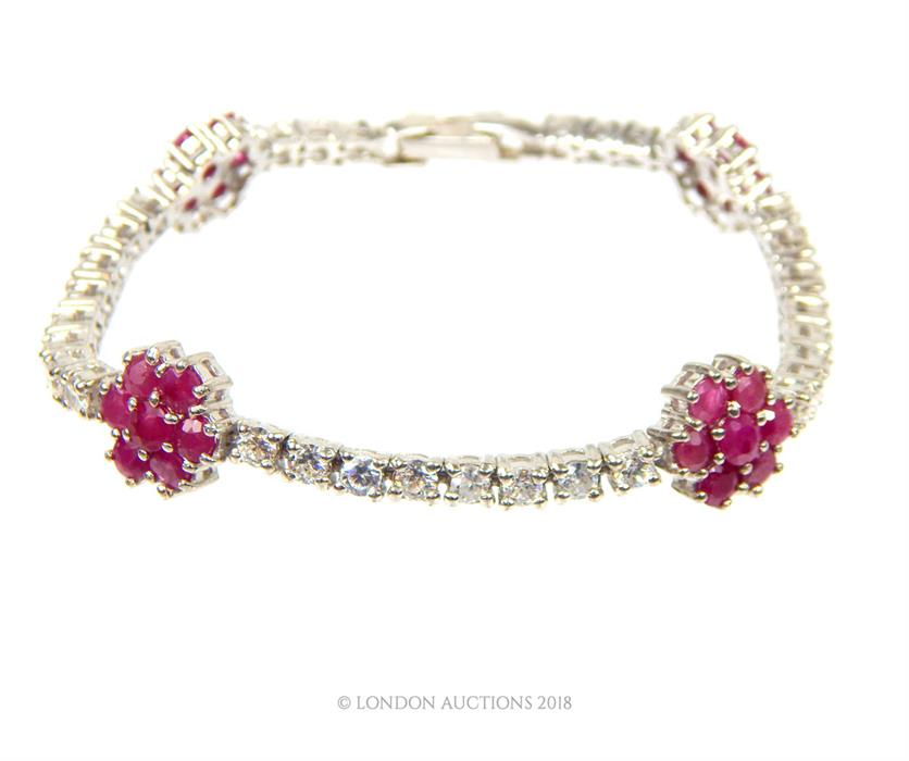 Lot 9 - A silver, white crystal and ruby bracelet