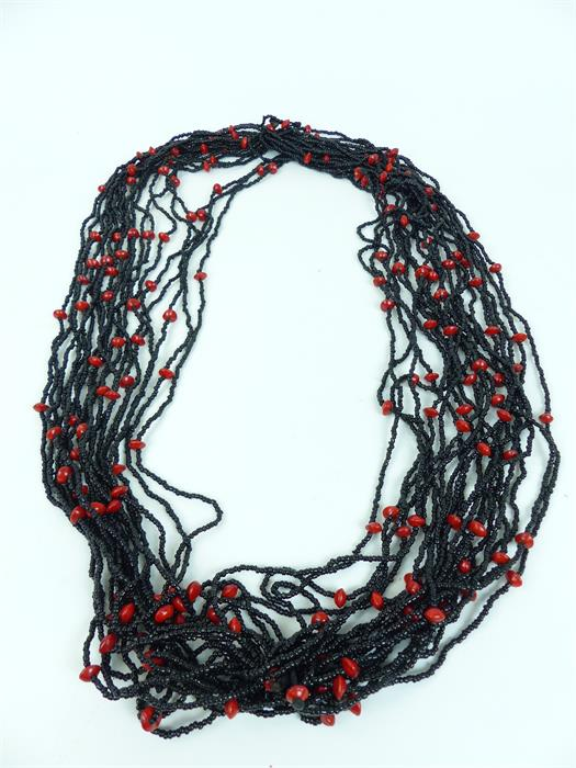 Lot 33 - A necklace with strands of black glass beads