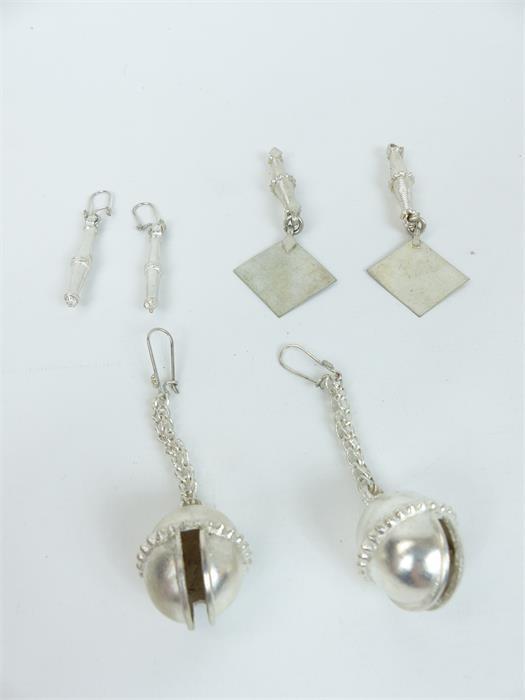 Lot 39 - Three pairs of white metal earrings