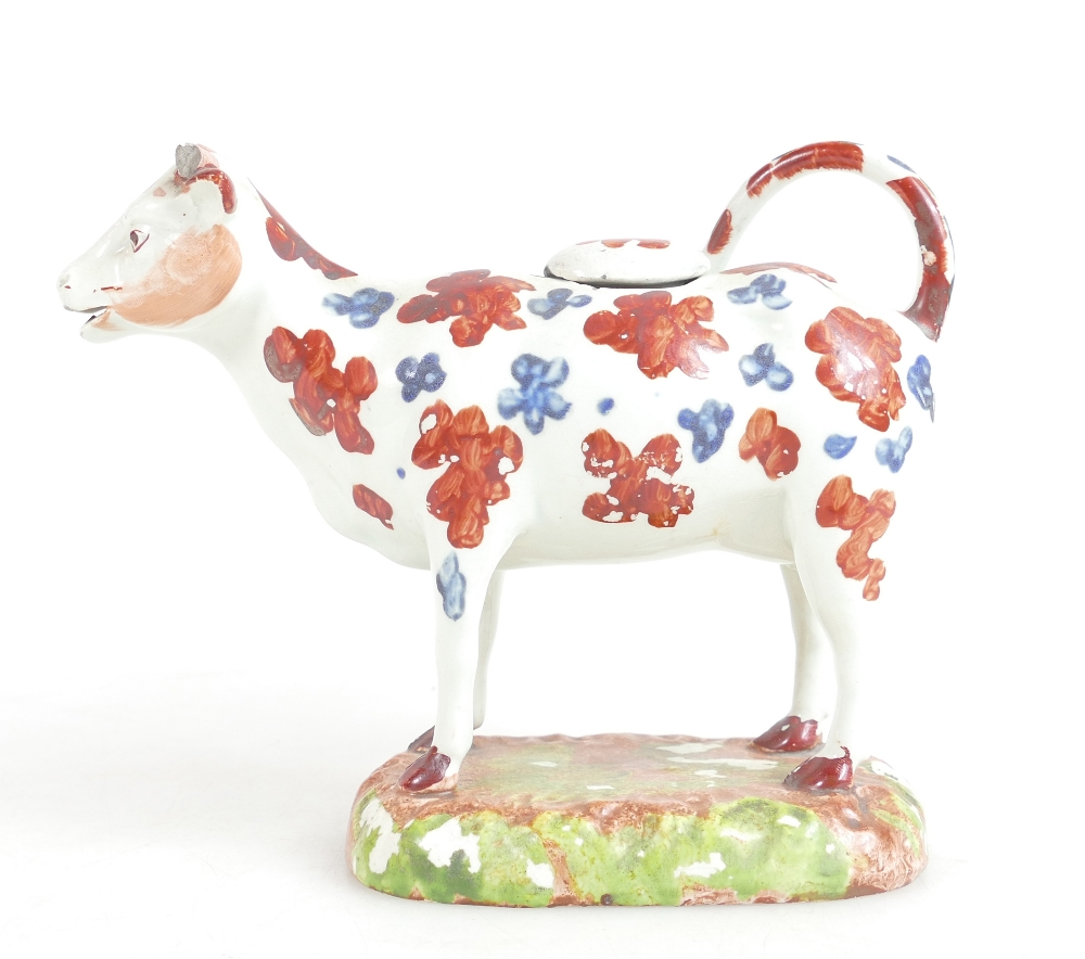 Lot 39 - 19th century Yorkshire pottery cow cream