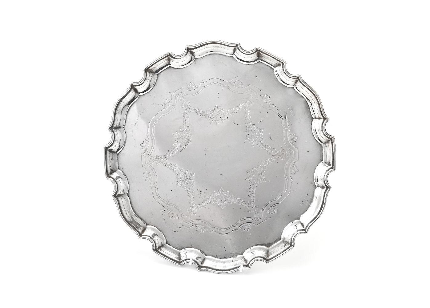 Lot 654 - A silver shaped circular salver
