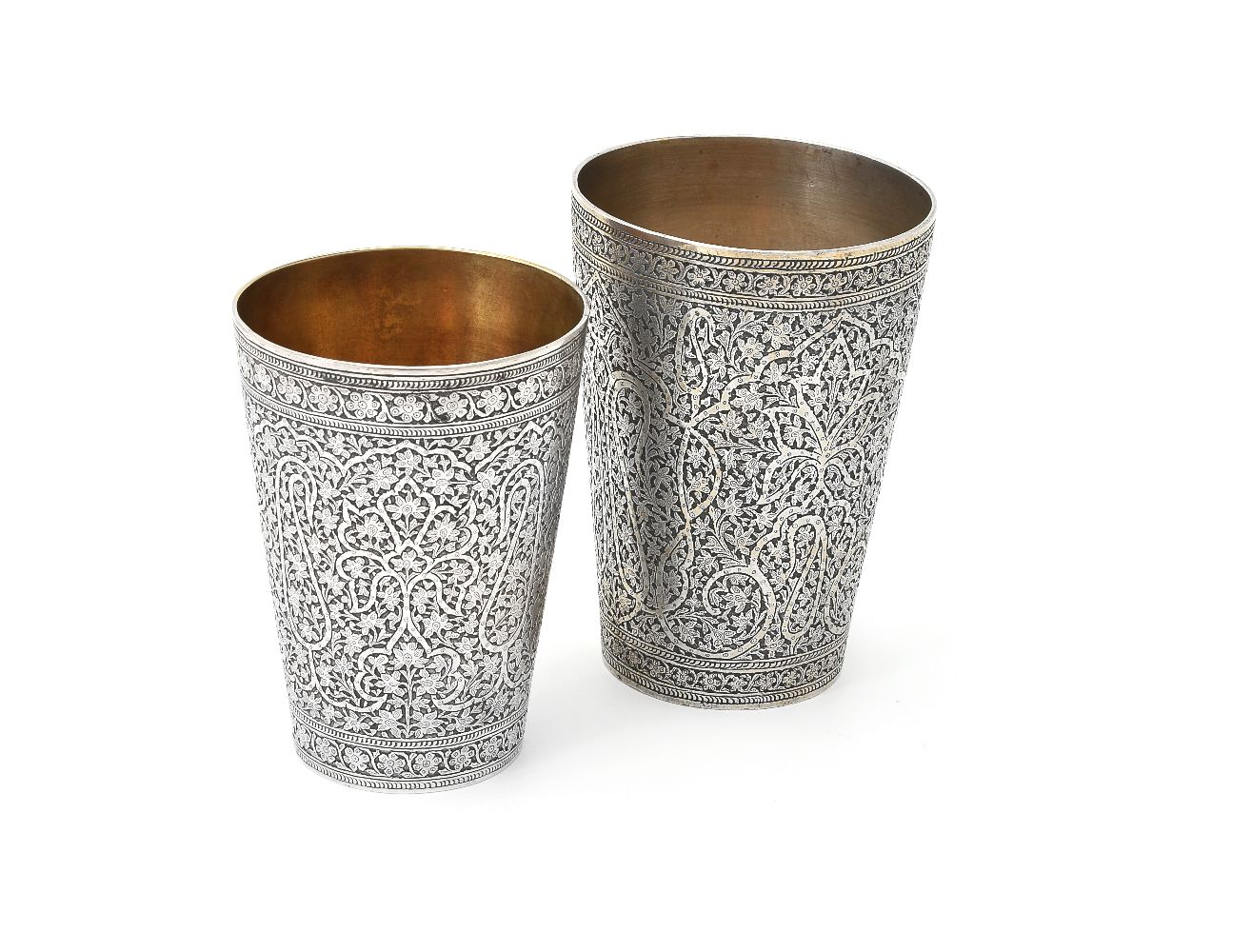 Lot 657 - Two Indian silver tapered beakers