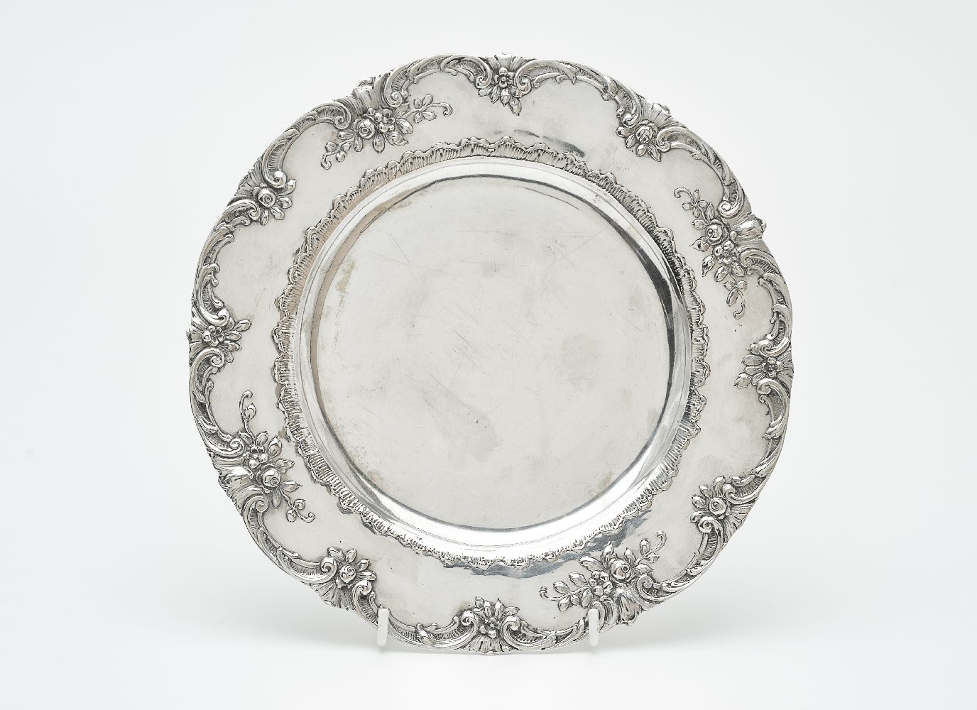 Lot 629 - A German silver shaped circular plate by Georg Roth & Co.