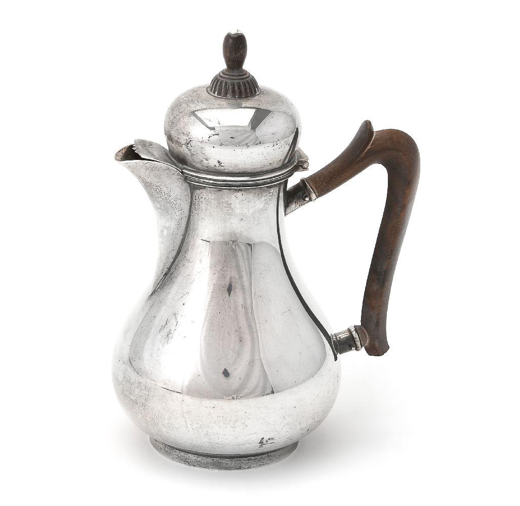 Lot 658 - A Dutch silver baluster small Bonton coffee pot by Zilverfabriek Voorschoten NV