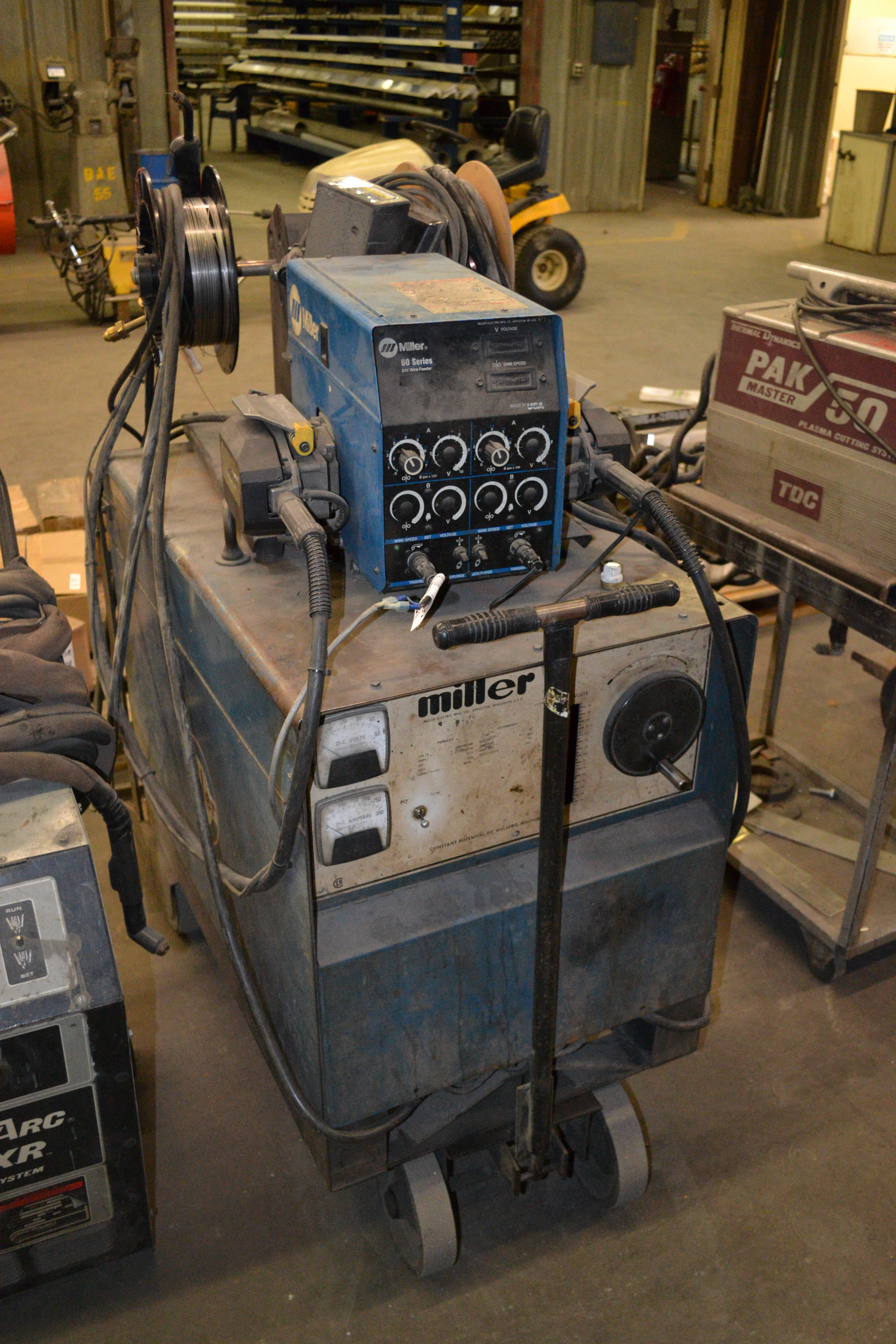 Lot 38 - Miller welder, model CP-250 TS with Miller 60 series 24 volt wire feeder  SN: HE791267