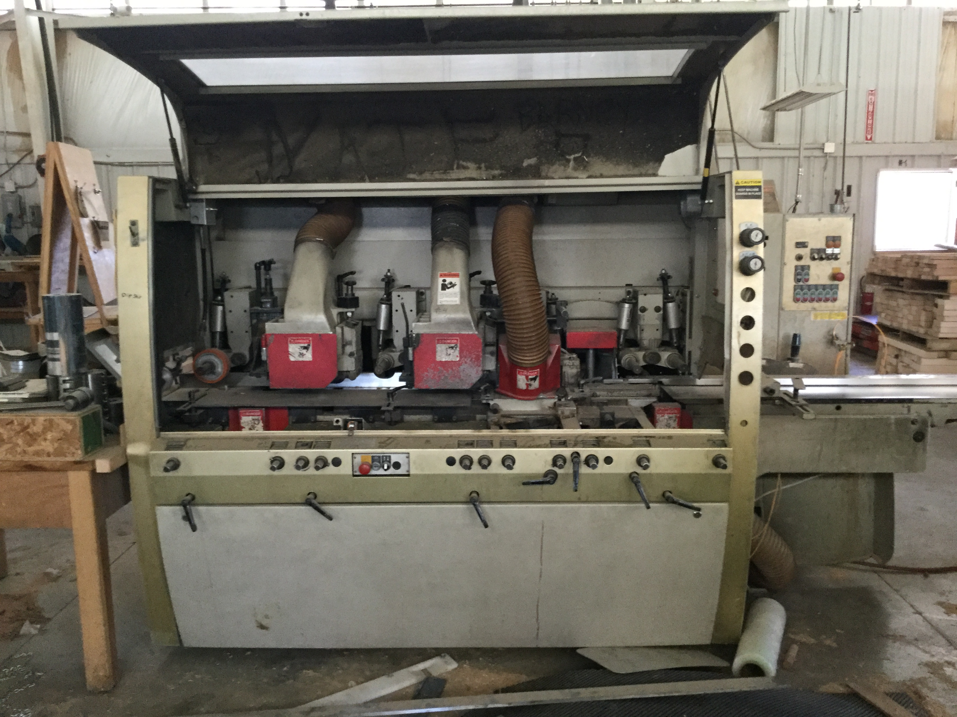Lot 3 - LIQUDATION -WEINIG UNIMAT GOLD 6-HEAD MOLDER SER# 97268 WITH A PALLET OF TOOLING