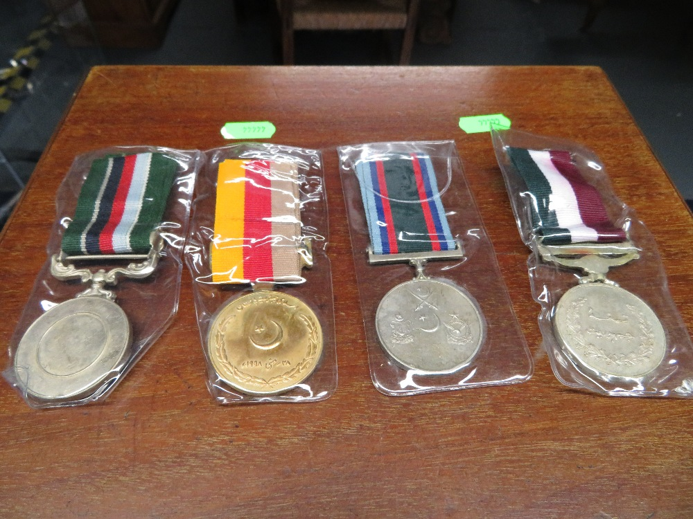 Lot 25 - Four Indian medals
