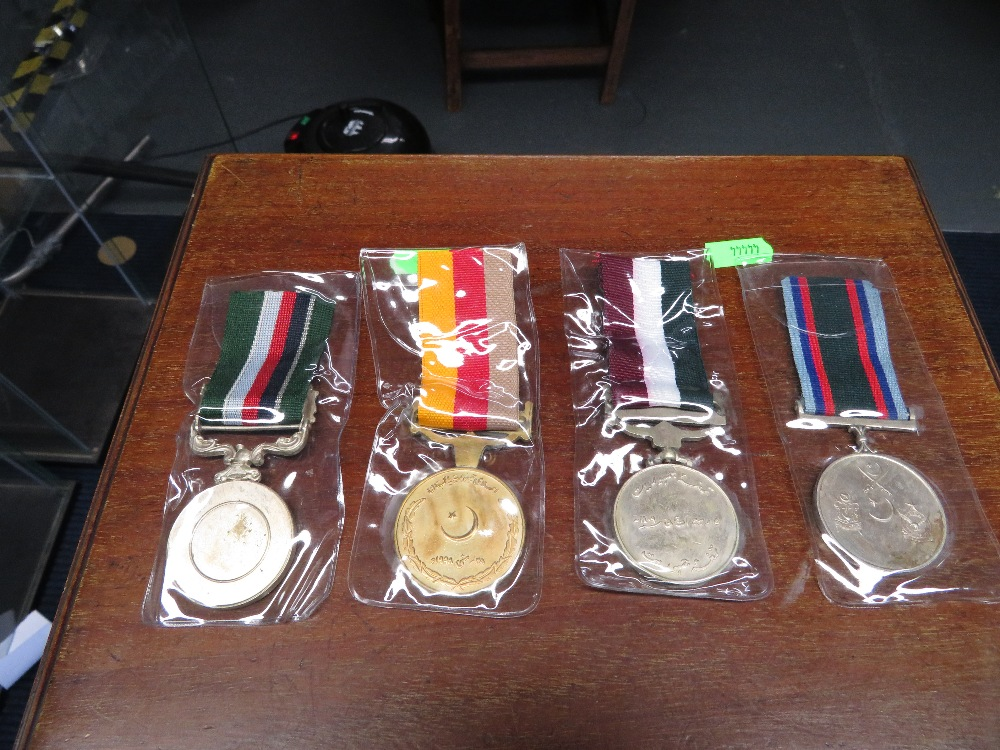 Lot 19 - Four Indian medals