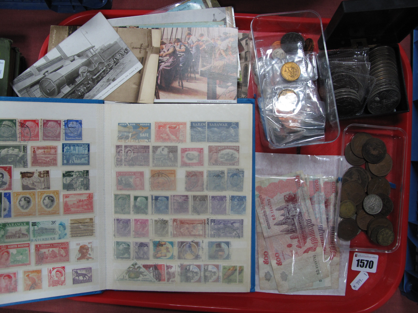 Lot 1570 - Postcards, S & G stamp album, quantity of coinage, Cambodian banknotes, etc:- One Tray
