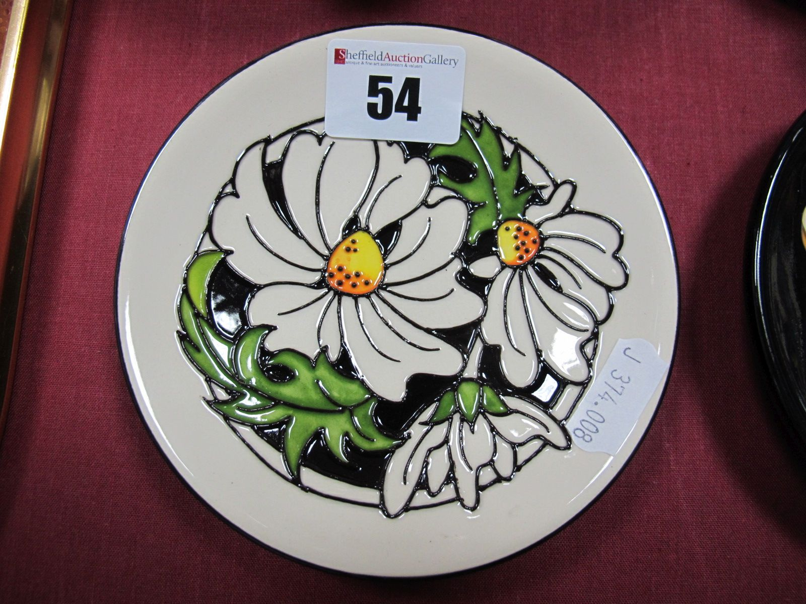 Lot 54 - A Moorcroft Pottery Coaster, decorated with the 'Phoebe Summer' design by Rachel Bishop, shape 780/