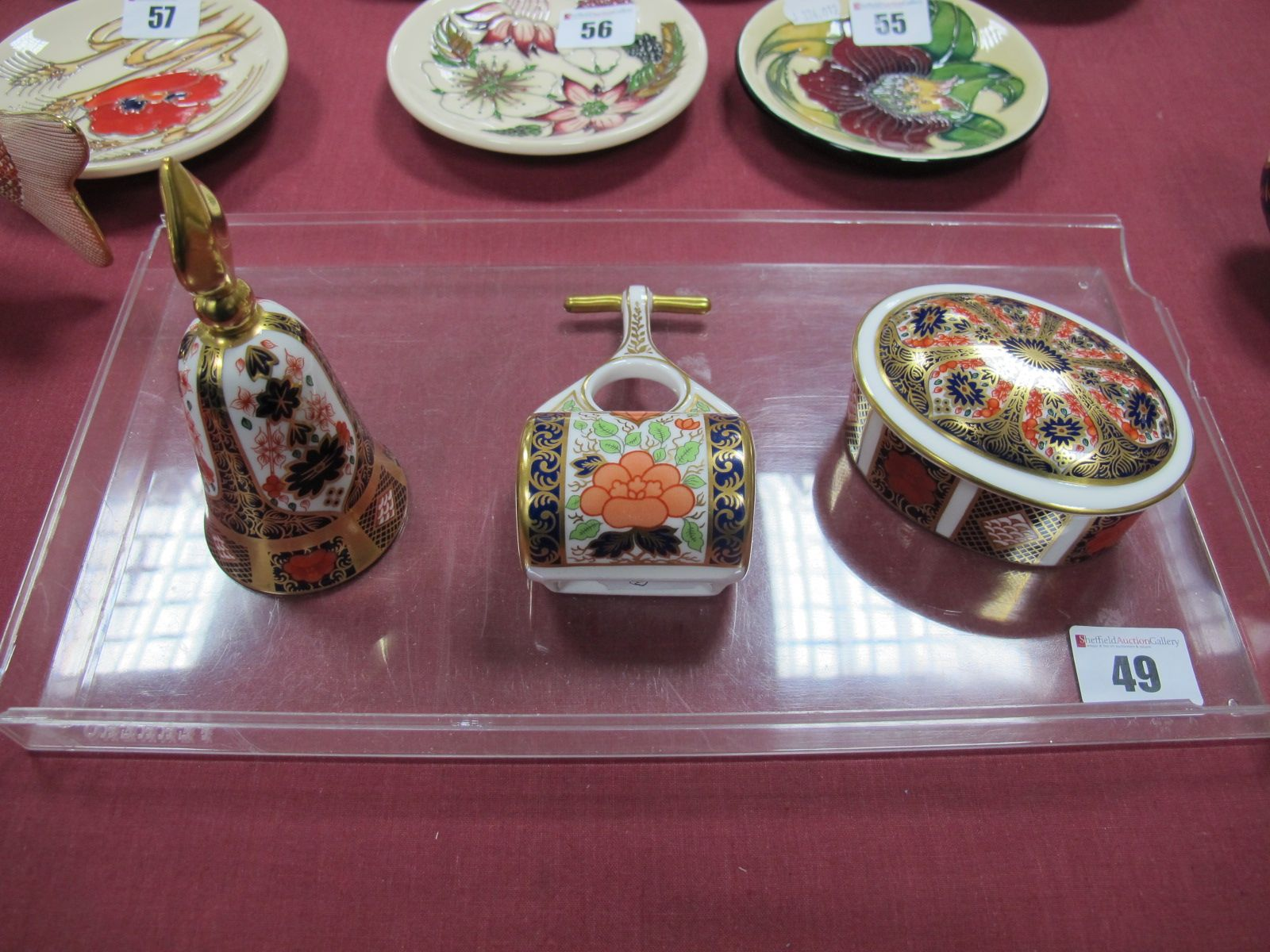 Lot 49 - A Royal Crown Derby Imari Oval Jar and Cover, pattern 1128, an Imari model bell and a model garden