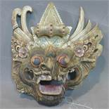 A Southeast Asian polychrome painted carved wooden dragon mask, with lead seal attached, H.23 W.23cm