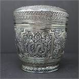 A Burmese white metal bowl embossed with figures of animals. Diameter 9 cm, H. 9,5 cm, Weight 4.02
