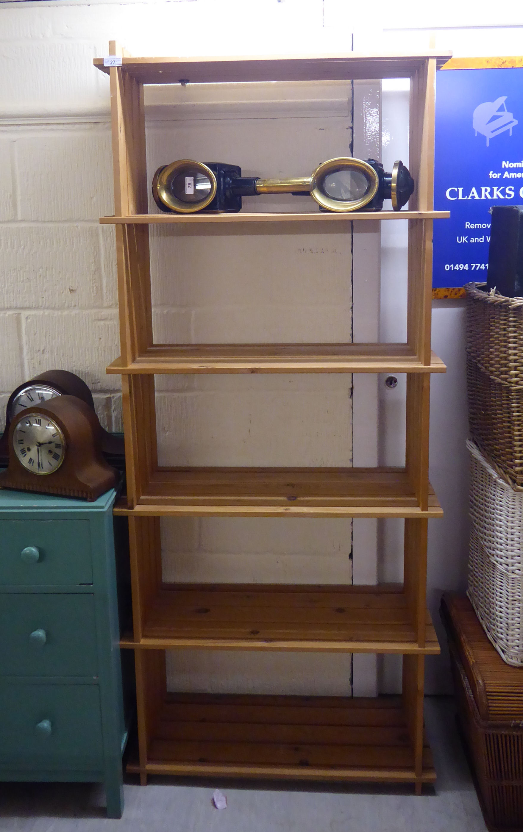 Lot 27 - A modern pine open front bookcase of planked construction with six shelves,