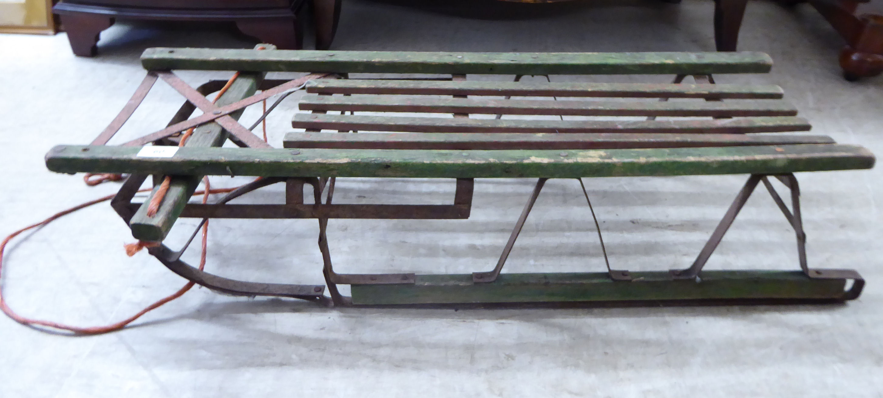 Lot 60 - A 'vintage' wooden sledge on metal runners RSF