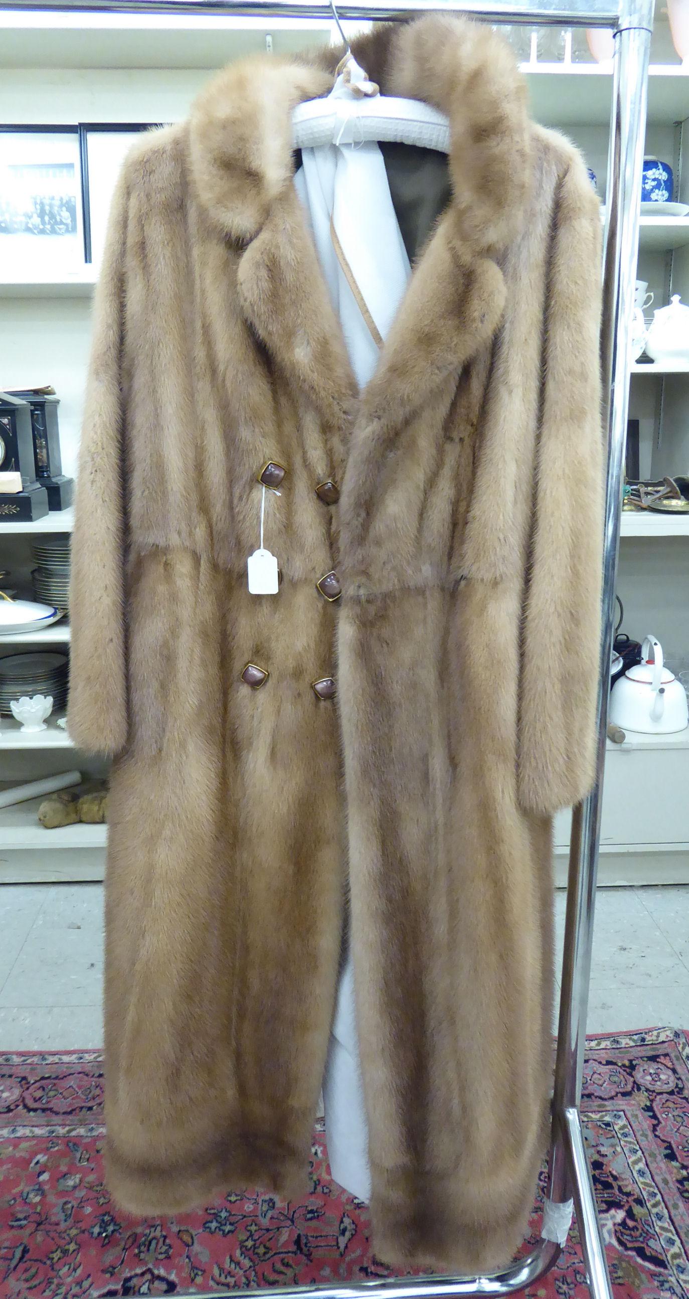 Lot 21 - A knee-length blonde mink coat with a belt back,