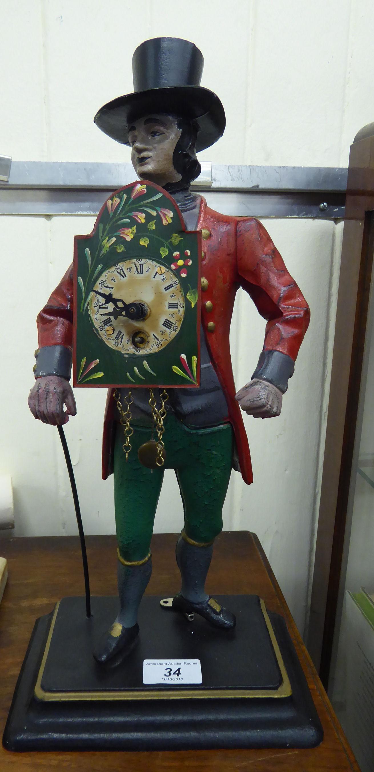 Lot 34 - A 'vintage' Dutch painted cast metal novelty 'clock seller' mantel timepiece, a standing man,