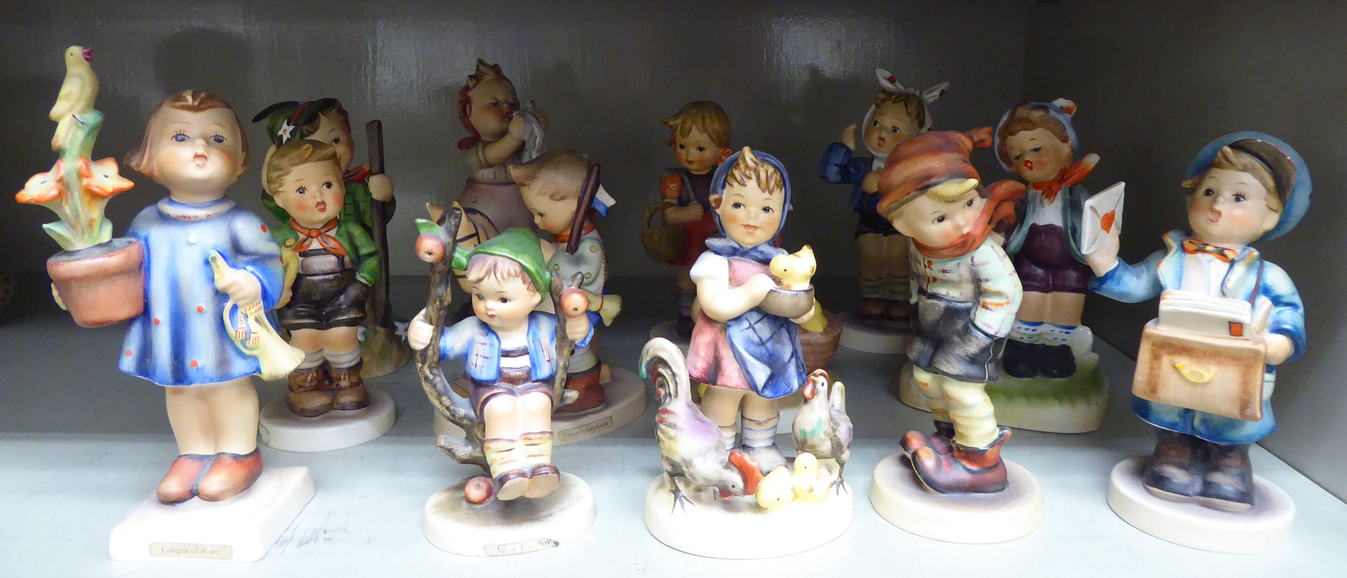 Lot 69 - Thirteen Goebel Hummel china figures: to include a young boy delivering letters 4.