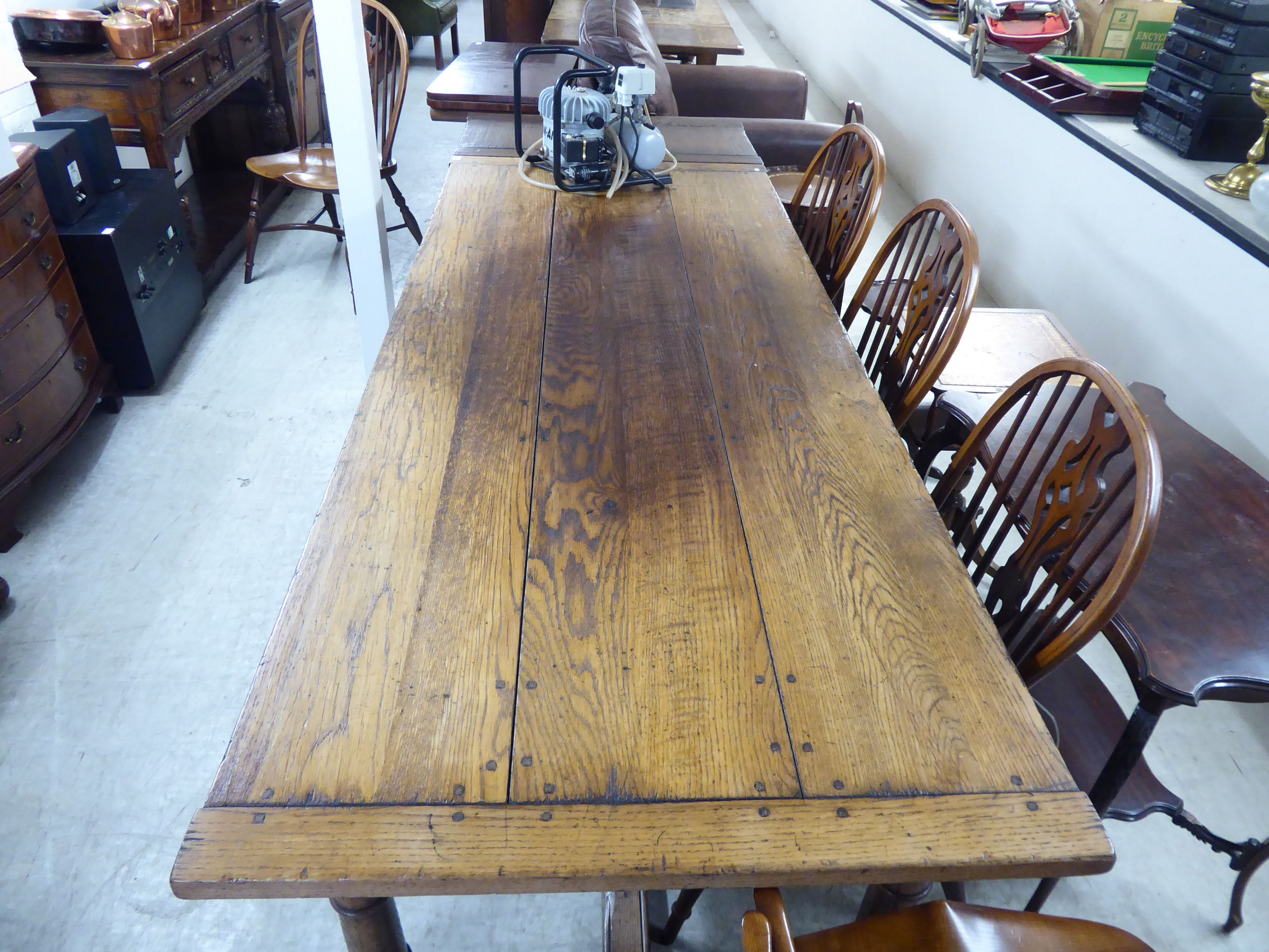 Lot 120 - A modern reproduction of an Old English style, oak draw leaf dining table,