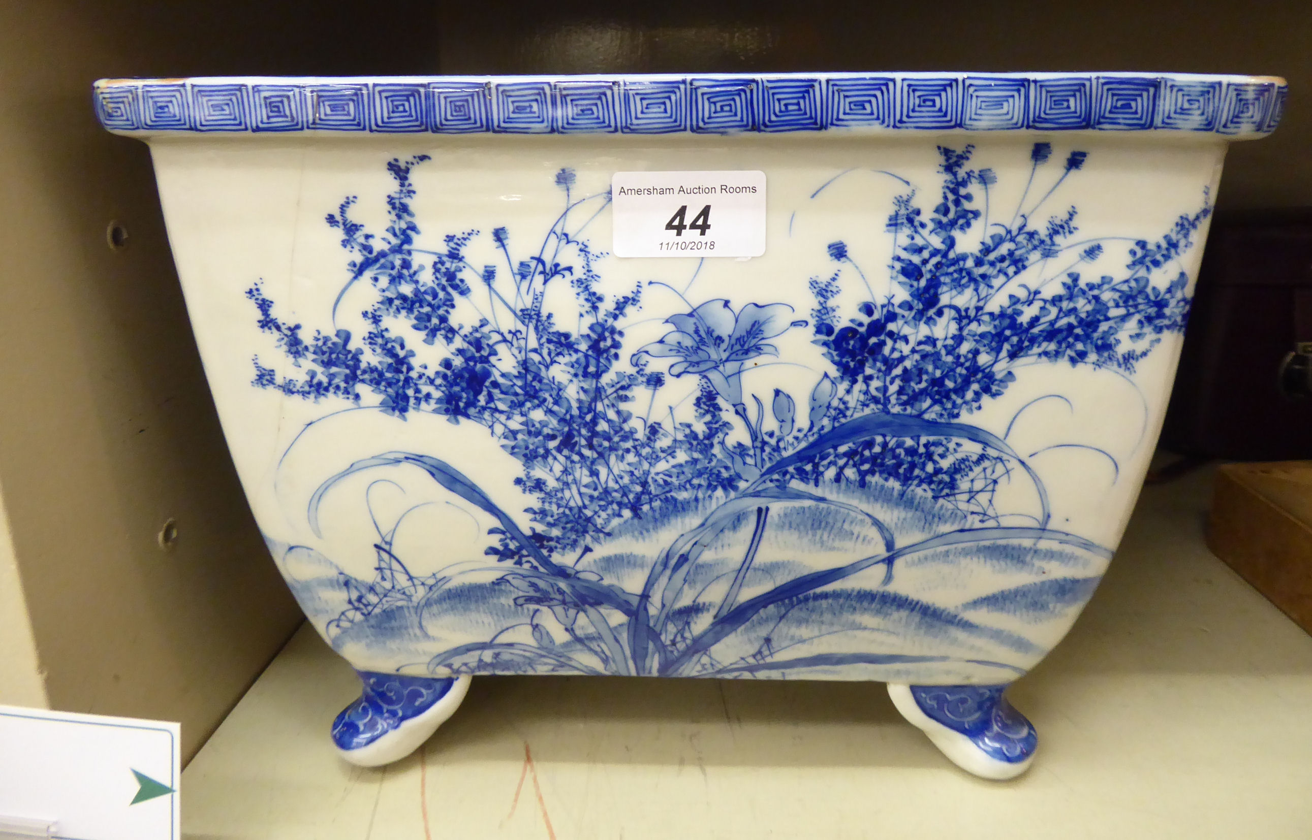 Lot 44 - A 20thC Japanese porcelain rectangular planter, on stubby feet,