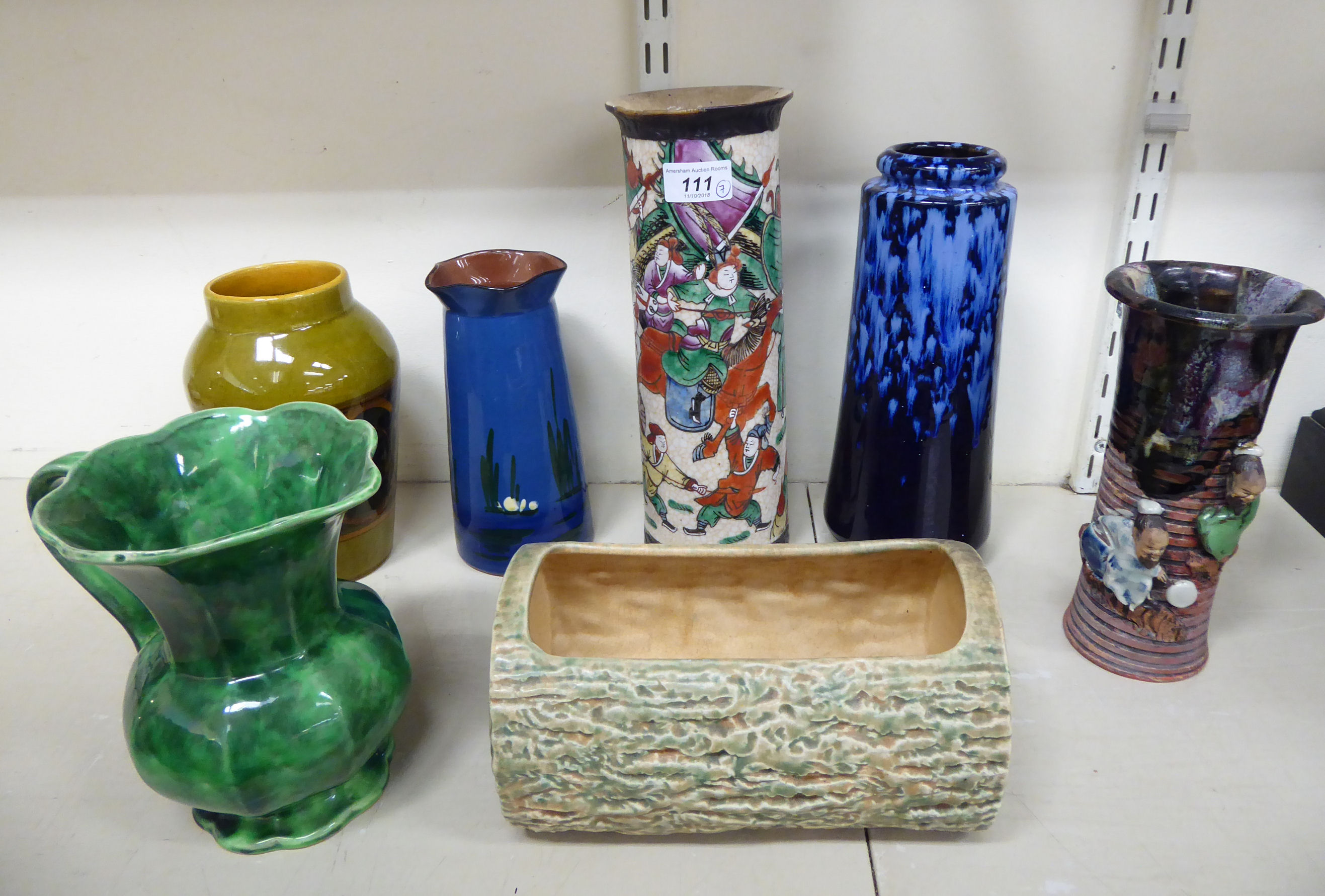 Lot 111 - Decorative ceramics: to include a Torquay pottery vase with a wavy border, decorated with a pond,