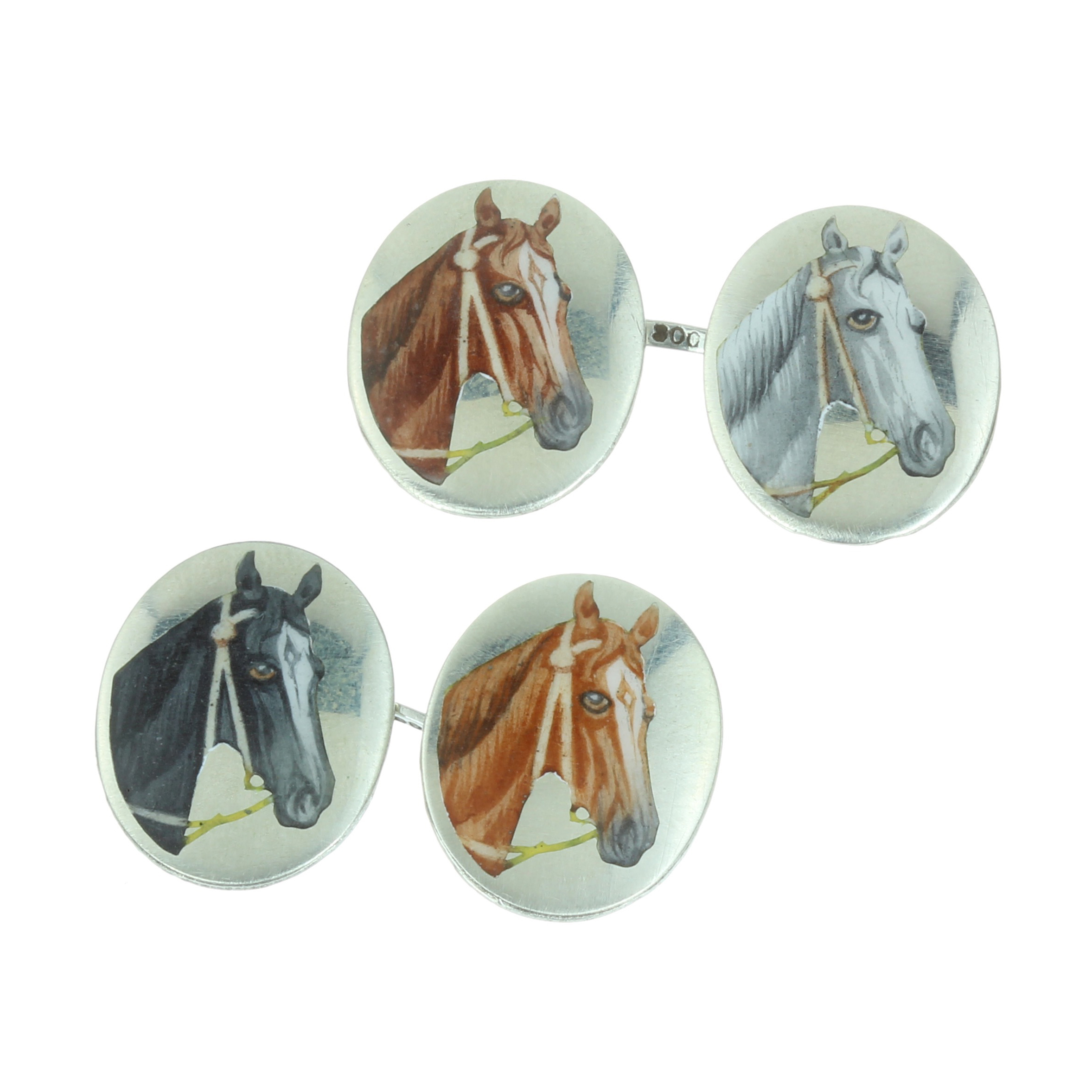 A PAIR OF ANTIQUE ENAMEL HORSE CUFFLINKS in silver, each formed of two oval faces decorated in