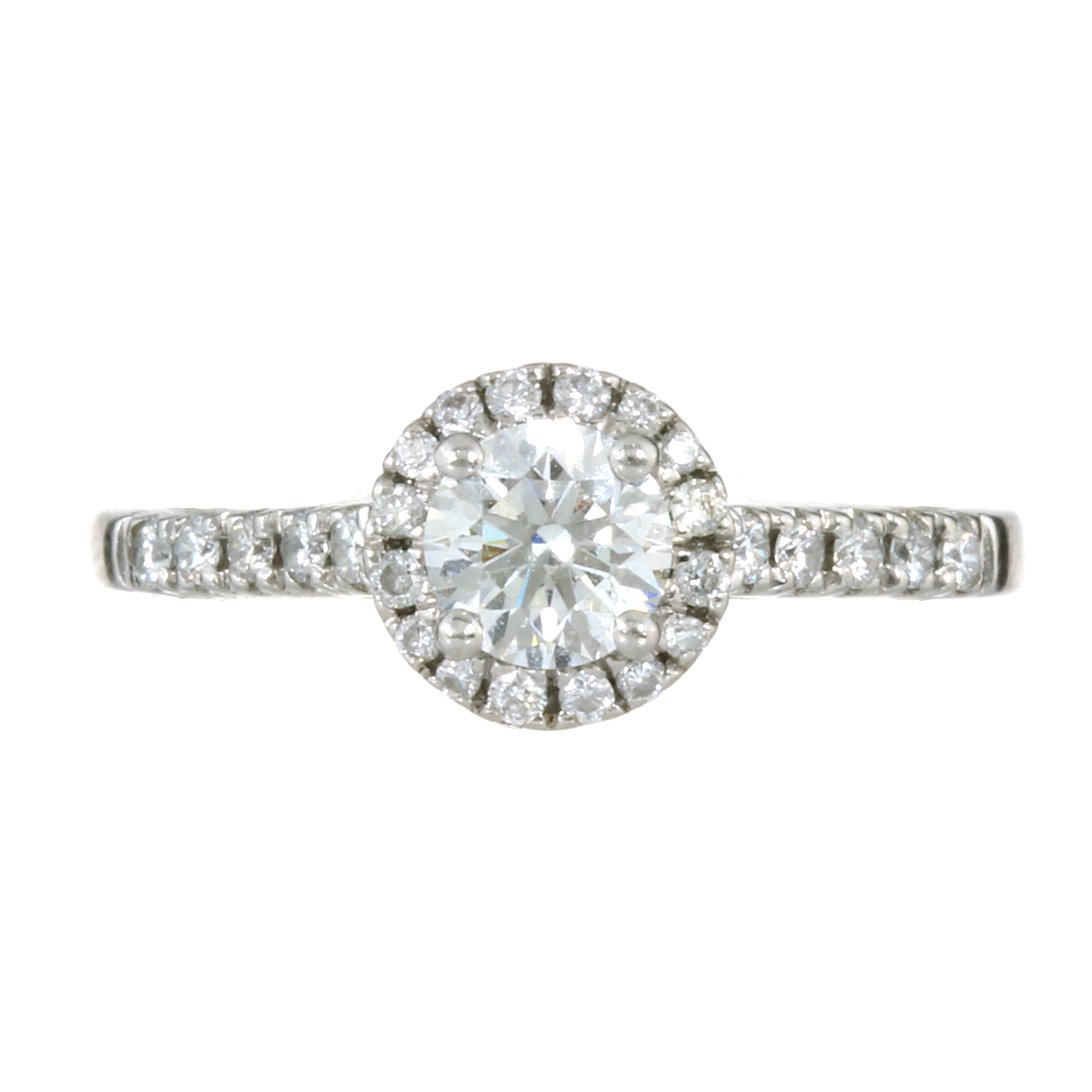 Los 25 - A 0.50 CARAT SOLITAIRE DIAMOND HALO ENGAGEMENT RING in platinum set with a round brilliant cut