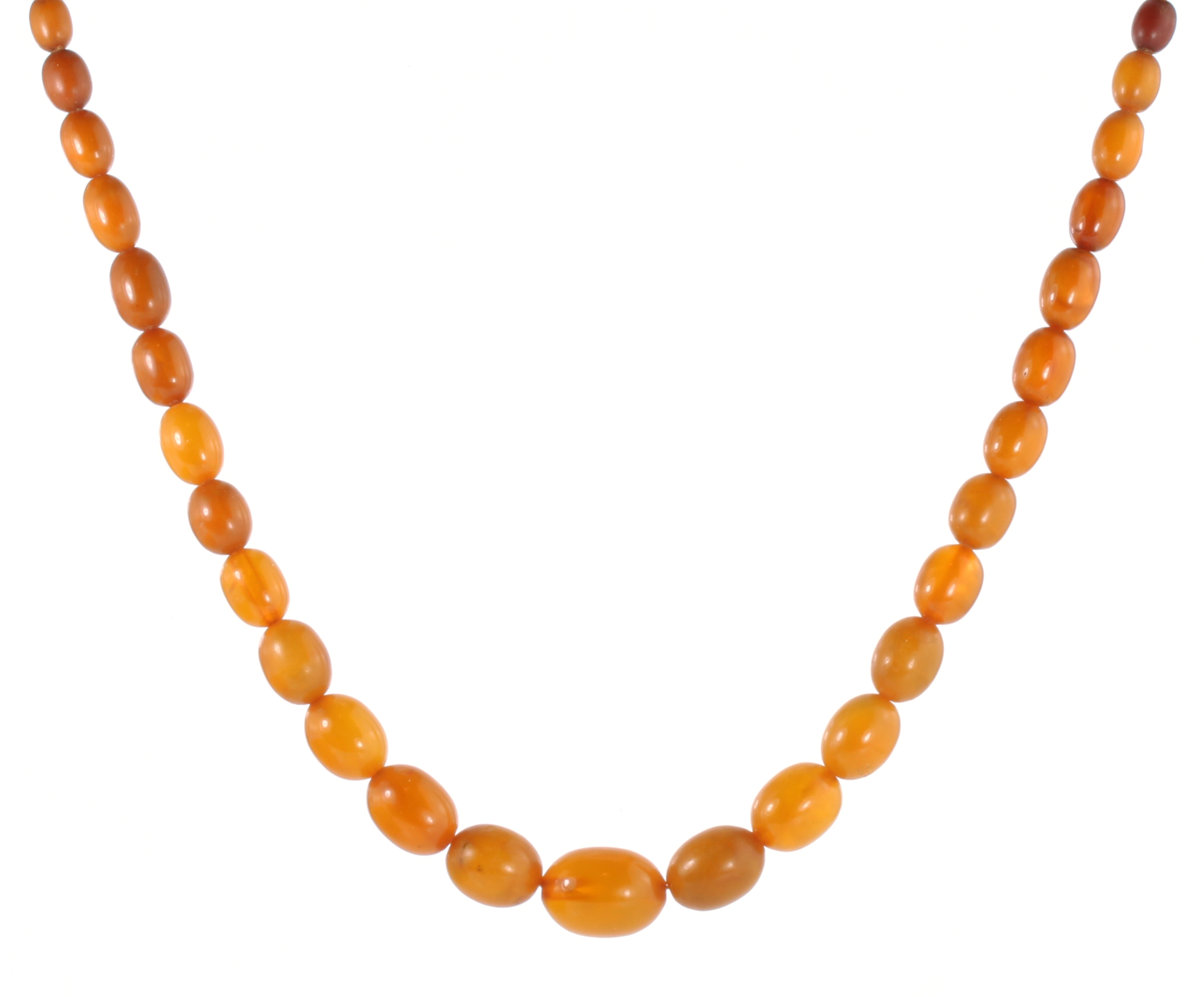 Los 10 - AN ANTIQUE NATURAL AMBER BEAD NECKLACE comprising a single row of seventy-three graduated polished