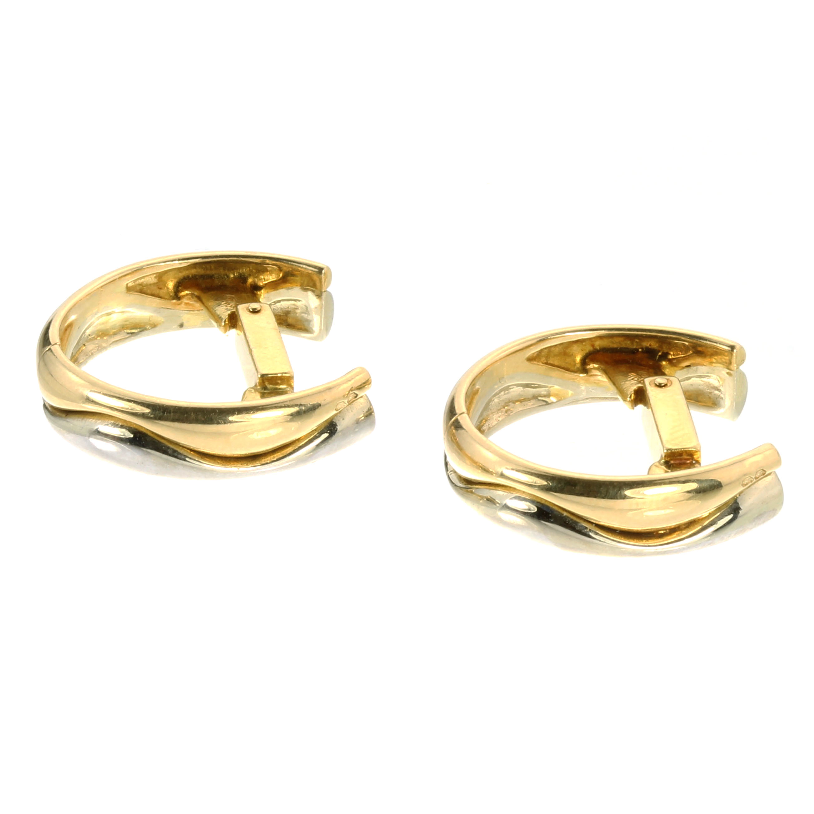 A VINTAGE PAIR OF CUFFLINKS, CARTIER in 18ct yellow and white gold, each incomplete hoop designed