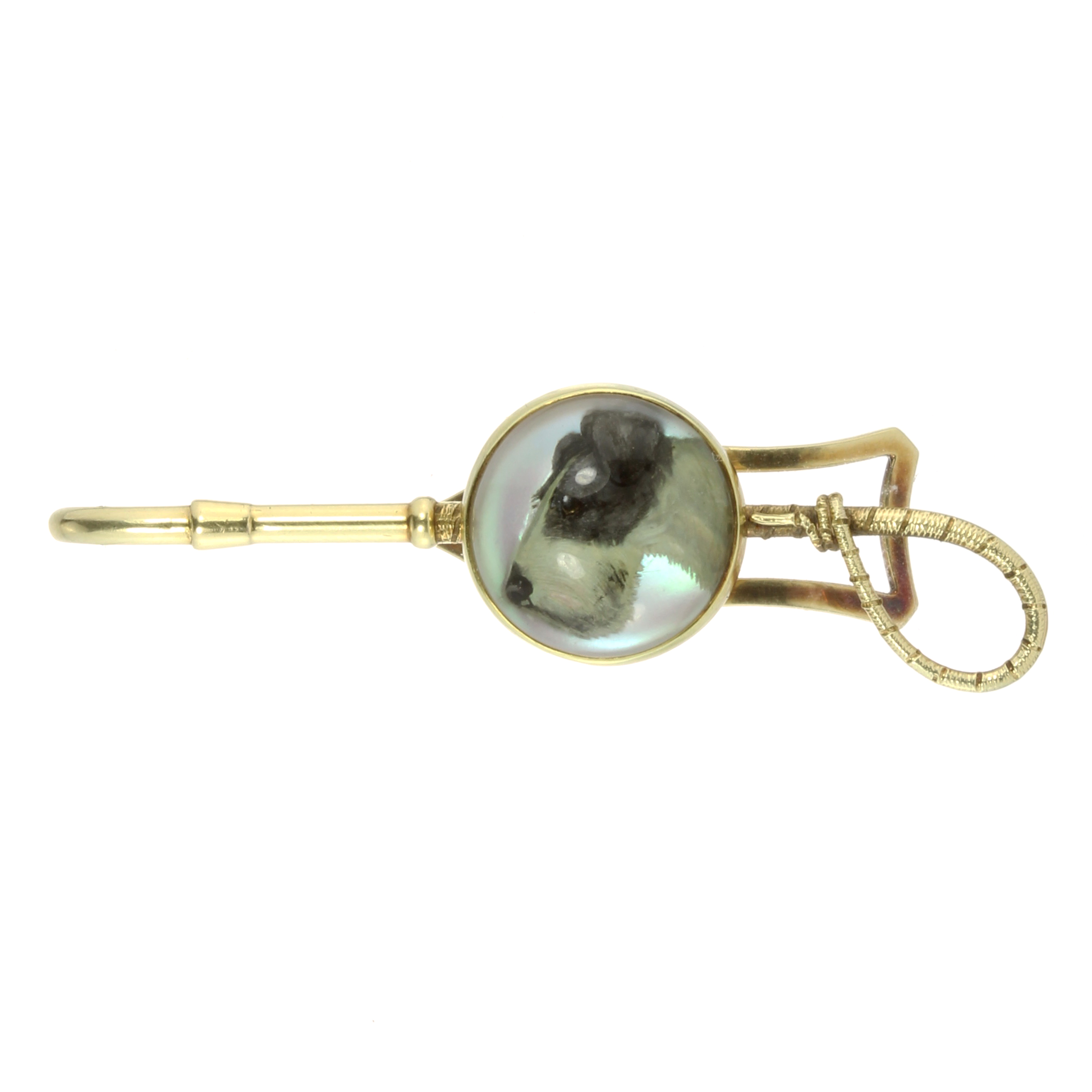 AN ANTIQUE ESSEX CRYSTAL DOG AND RIDING CROP TIE CLIP in high carat yellow gold, the riding crop set