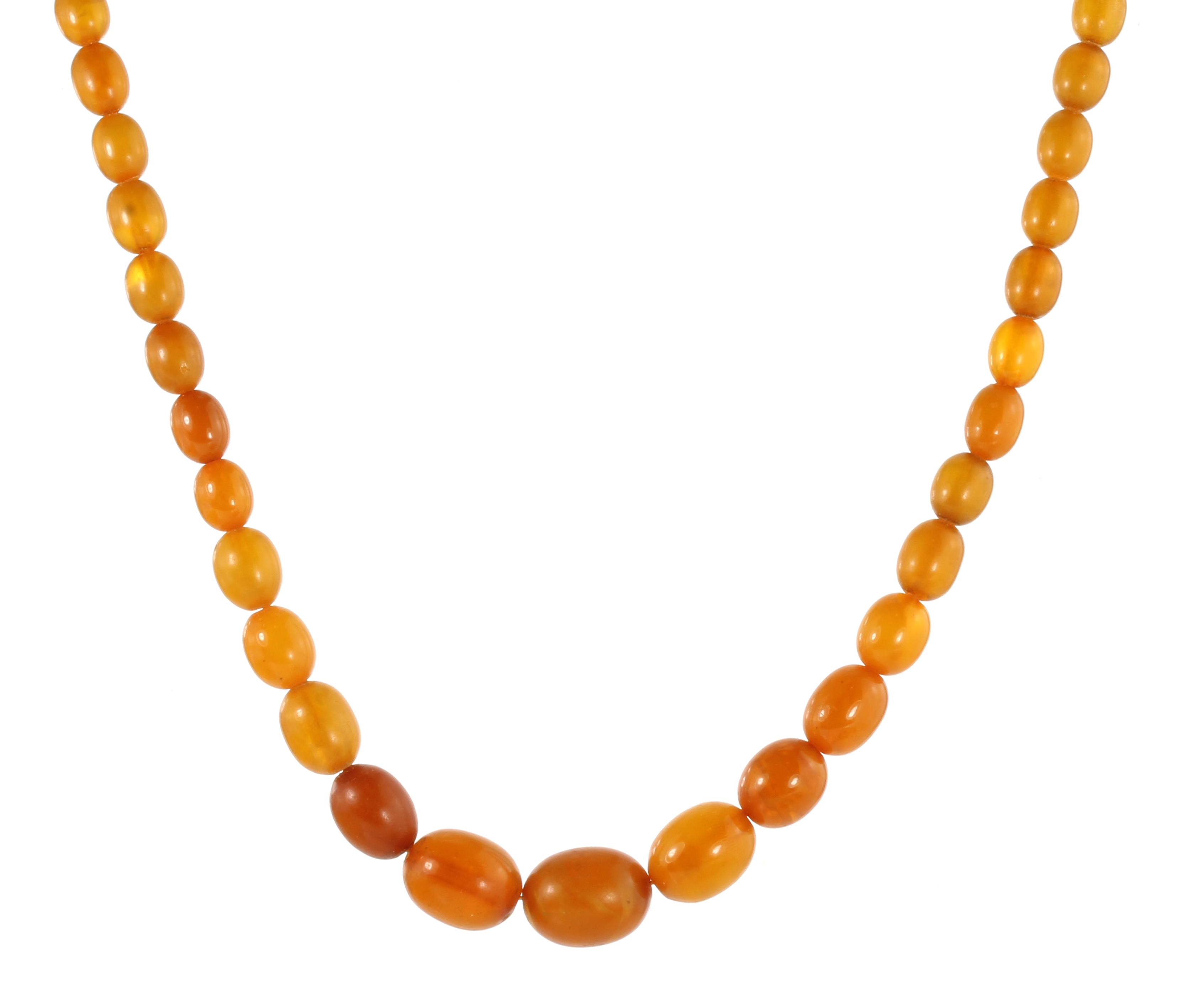 Los 12 - A NATURAL AMBER BEAD NECKLACE comprising a single row of seventy-six graduated polished oval beads
